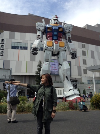 """My attempted soldier pose with the Odaiba """"Life Sized"""" Gundam. I'm such a geek .__."""